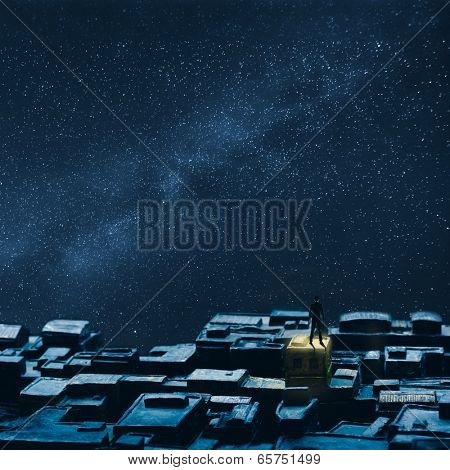 Single businessman standing on the roof under sky of stars, concept of lonely, single, peace etc.