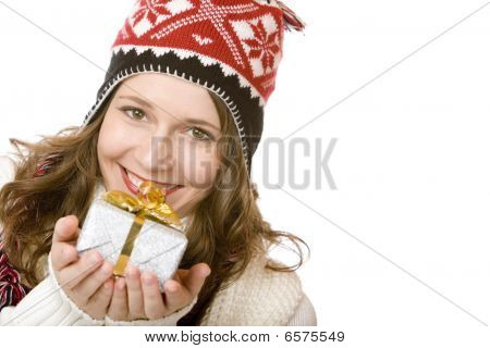 Young Happy Woman With Cap Is Holding Christmas Gift In Hands