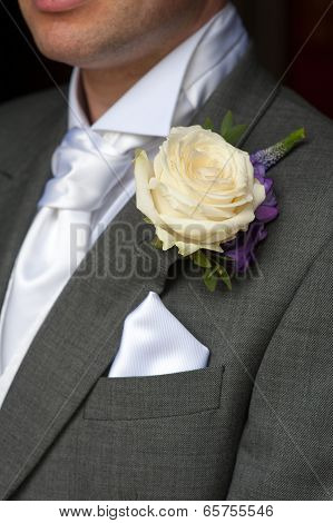 Man Wearing A Rose Buttonhole