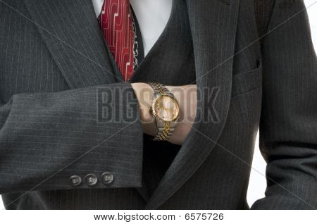 Upper Class Man Reaching In Pocket With Gold Watch
