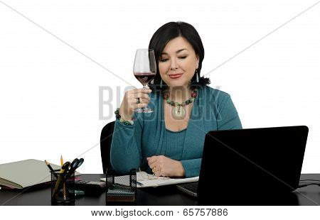 Businesswoman Toasting A Red Wine Glass By Skype Conversation