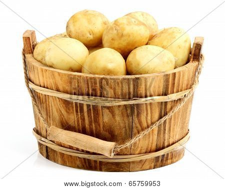 New Potatoes In A Wooden Bucket.