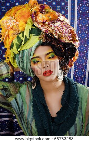 beauty bright woman with creative make up, many shawls on head like cubian woman