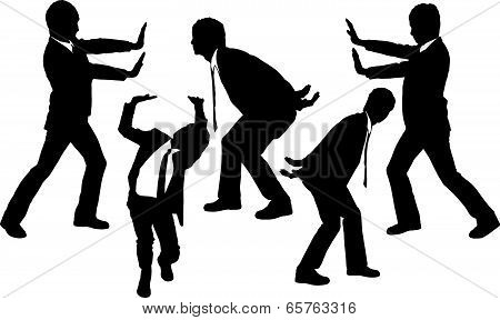 Silhouettes Of Business Men Holding Something Heavy