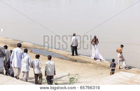 Pilgrims Take Ritual Bathing In Holy Lake