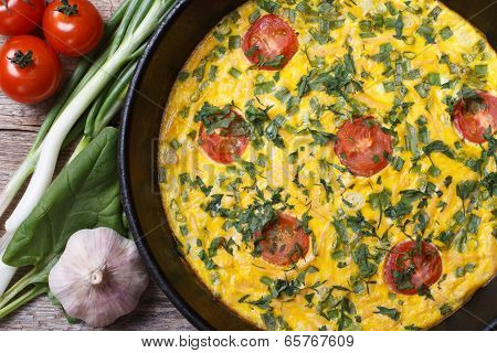 Frittata In A Frying Pan, And The Ingredients On The Table