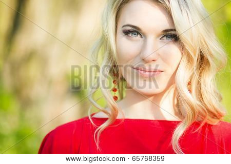 Portrait of a beautiful young blonde woman in the image of the bride.