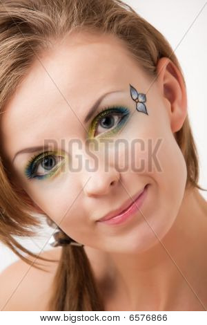 Portrait Of A Girl With Colorful Eyes