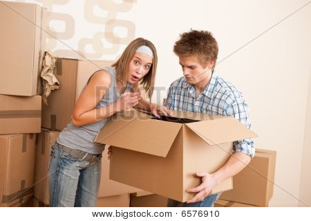 New House: Young Couple Moving Box, Unpacking