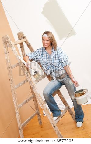 Home Improvement: Smiling Woman With Paint And Brush