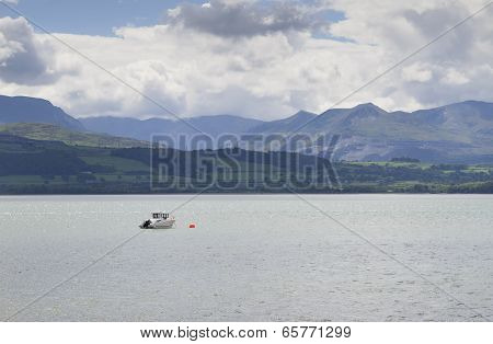 Single boat moored near Beaumaris in Anglesey