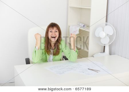 Exulting Young Woman At Office On Workplace