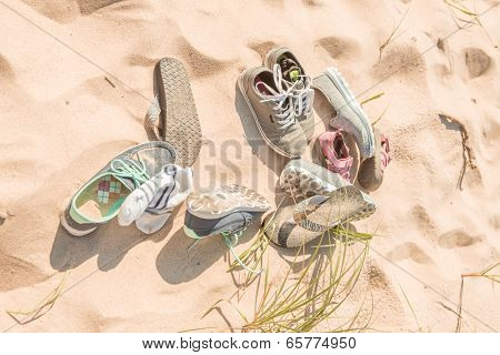 Pile of shoes on the beach