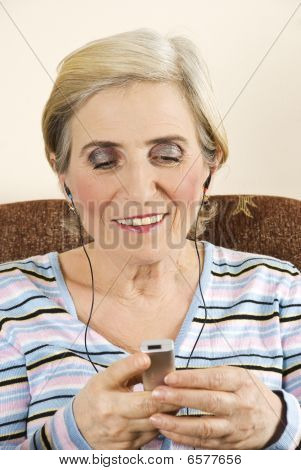 Happy Senior Woman Listen To M Usic