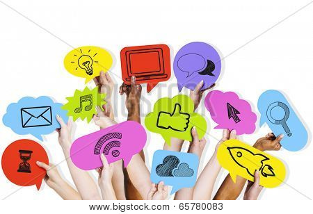 Hands holding social media icons.