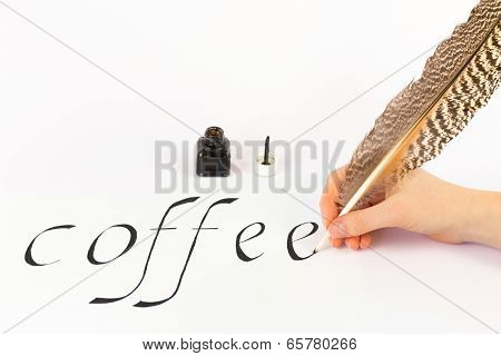 Hand writing the word coffee