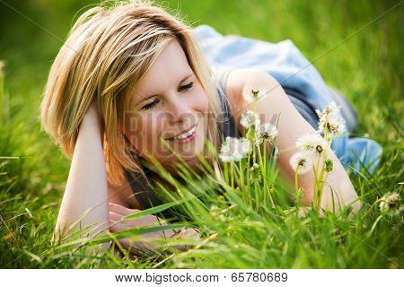 The Girl Lying On The Green Grass.