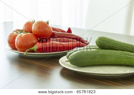 Tomato, Cucumber, Pepper On Plate