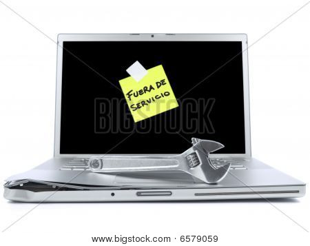 Laptop With Sticky Note And Tool