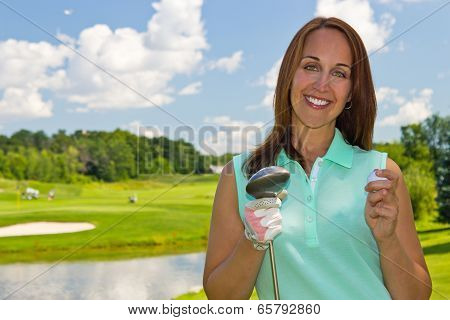 Attractive Woman At The Golf Course On A Beautiful Summer Day