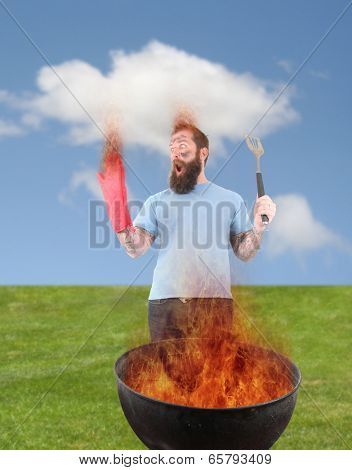 a man grilling with a fire that's too big