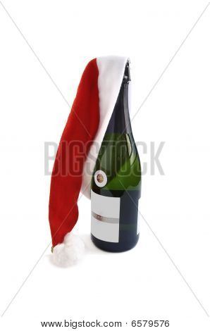 Bottle Of Champagne With Santa Red Hat.