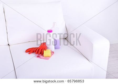 Cleaners for upholstered furniture on sofa close-up