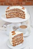 picture of pecan  - A Piece Of Hummingbird Cake With Pecans And Cream Cheese Frosting