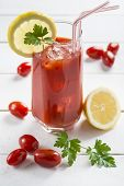picture of bloody mary  - Bloody Mary cocktail garnished with a lemon slice and parsley leaves - JPG