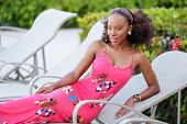image of jamaican  - Stock image of a young Jamaican model posing by the pool deck - JPG