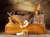 picture of joinery  - a old wooden plane in a workshop - JPG