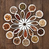 picture of holistic  - Large chinese herbal medicine selection in china bowls over old oak background - JPG
