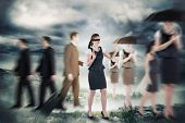 picture of blindfolded man  - Redhead businesswoman in a blindfold against stormy sky with tornado over landscape - JPG