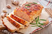 stock photo of meatloaf  - Homemade ground meatloaf with ketchup and rosemary - JPG
