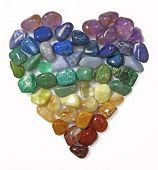 picture of gem  - Close up cut out of a Heart shaped using rainbow coloured tumbled Gem Stones on white background - JPG