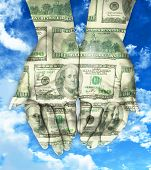 pic of indian money  - hands with money on blue sky magic - JPG