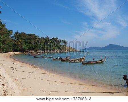 longtail boats in bay of Phuket island, Thailand.