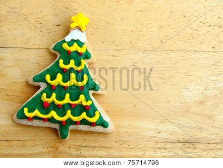 Decorated Christmas Gingerbread On Wooden Background