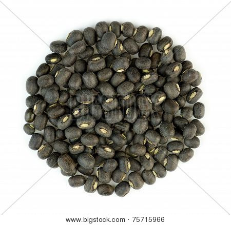 Black Urad Dal Lentil Beans In A Bile Isolated Against White