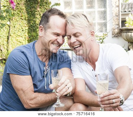 Two attractive gay men enjoying an afternoon outdoors