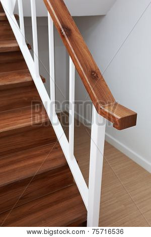 Wooden Staircase Railing In A White Modern House