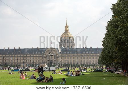 People resting in the park near main entrance Les Invalides. Paris France