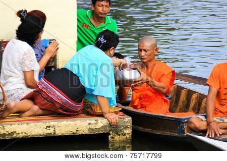 Nonthaburi, Thailand - November 6 : Buddhist Monk Is The Alms On Morning At Sai Noi Floating Market