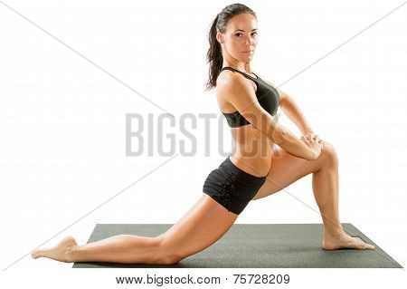 Sexy Young Yoga Woman Doing Yogic Exercise On Isolated White Background