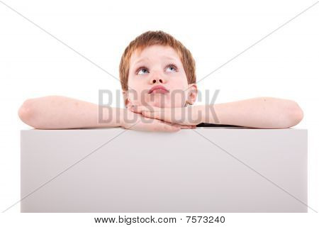 Cute  Boy Looking Up With White Board