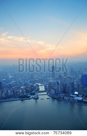 Shanghai aerial view with urban architecture and sunset