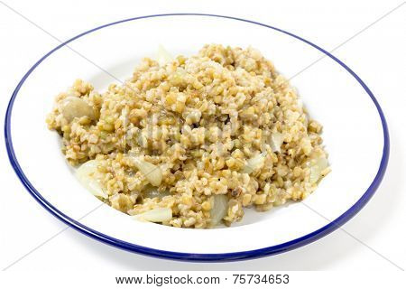 Freekeh, or frikeh, fire-dried green wheat, cooked with pearl onions and stock. The grain is being hailed as a