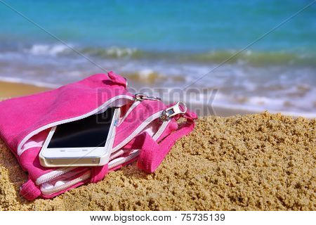 Smartphone In The Woman Purse On The Beach
