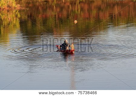 A man on his boat under the sunshine of fall season at Bao Loc city, Lam Dong province, highland cen