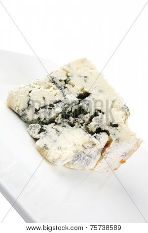 soft moldy blue cheese on white background